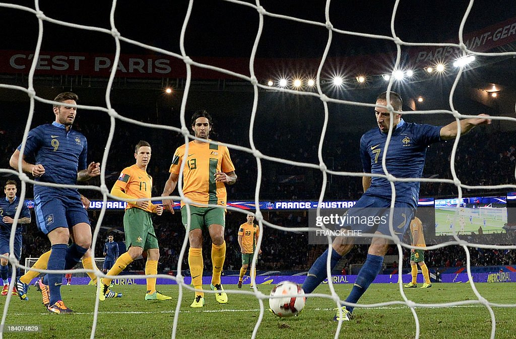 France's forward Franck Ribery (R) scores a penalty shot during the France vs Australia friendly football match, on October 11, 2013 at the Parc des Princes stadium in Paris.