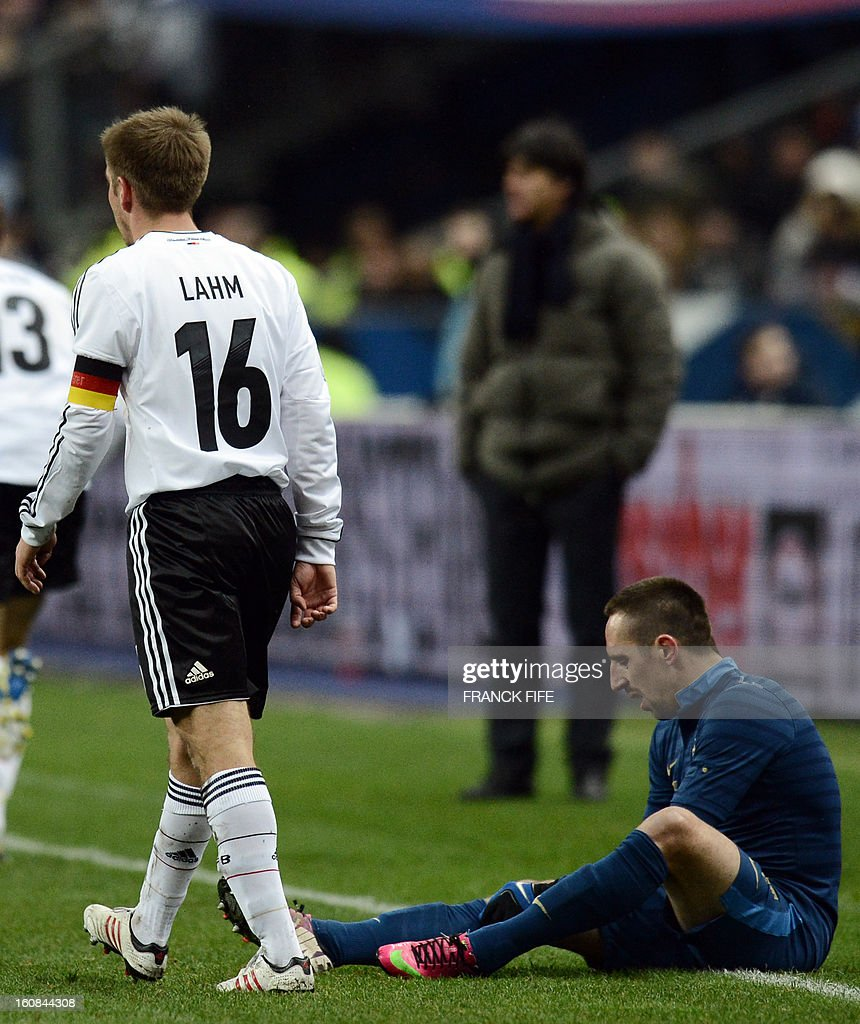 France's forward Franck Ribery sits on the ground after picking up a knock during a friendly international football match between France and Germany on February 6, 2013 at the Stade de France in Saint-Denis, near Paris.