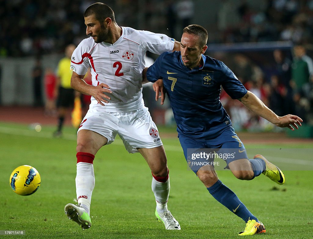 France's forward Franck Ribéry (R) vies with Georgia's defender Ucha Lobjanidze during the FIFA World Cup 2014 qualifying football match Georgia vs France on September 6 2013 at the Boris Paichadze stadium in Tbilisi.