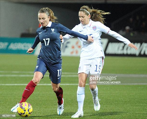 France's forward Gaetane Thieney vies for the ball with US' midfielder Morgan Brian during the Women's friendly football match between France and the...