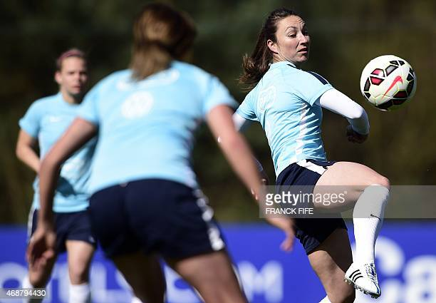 France's forward Gaetane Thiney controls the ball during a training session in Clairefontaine en Yvelines southwest of Paris on April 7 ahead of the...
