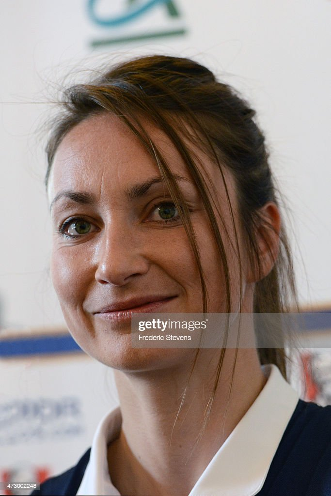 France's forward Gaetane Thiney (C) during a press conference before a training session as part of the preparation for a upcoming FIFA 2015 World Cup at Canada, in Clairefontaine-en-Yvelines on May 11, 2015 in Clairefontaine, France.