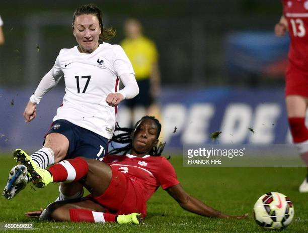 France's forward Gaetane Thiney fights for the ball with Canada's defender Kadeisha Buchanan during the friendly football match France vs Canada on...
