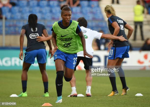 France's forward Grace Geyoro warms up prior to the friendly match between France and Belgium on July 7 2017 at the Mosson stadium in Montpellier /...