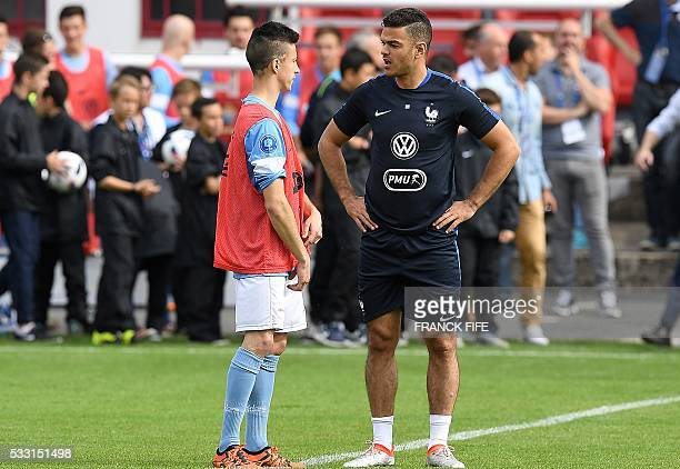 France's forward Hatem Ben Arfa speaks with a player of Bayonne ahead of the friendly football match between French national football team and...