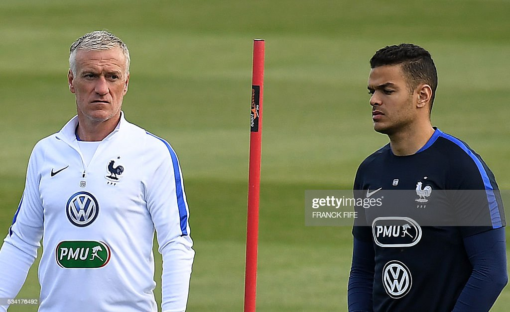 France's forward Hatem Ben Arfa (R) walks next to France's head coach Didier Deschamps (L) during a training session in Clairefontaine as part of the team's preparation for the upcoming Euro 2016 European football championships, on May 25, 2016. / AFP / FRANCK
