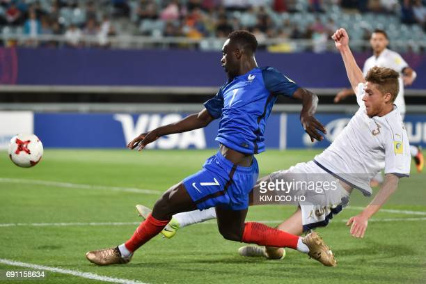 France's forward JeanKevin Augustin fights for the ball with Italy's defender Federico Dimarco during their U20 World Cup round of 16 football match...