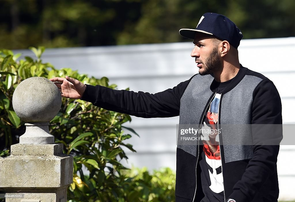 France's forward Karim Benzema arrives at the French national football team training base in Clairefontaine on September 1, 2014 on the first day of their training ahead of the friendly football match against Spain to be held on September 4.