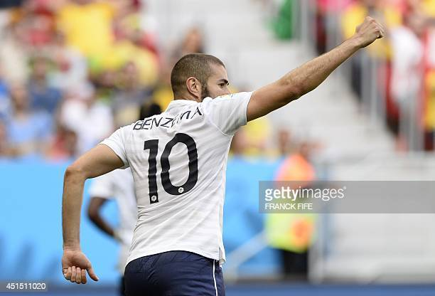 France's forward Karim Benzema celebrates after his team scored a goal during the round of 16 football match between France and Nigeria at the Mane...