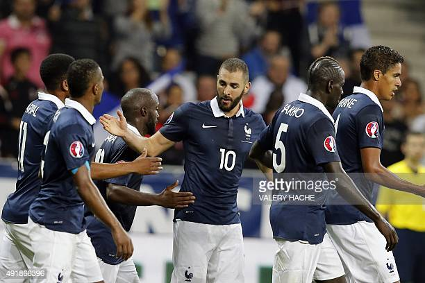 France's forward Karim Benzema celebrates with teammates after scoring a goal during the friendly football match between France and Armenia on...
