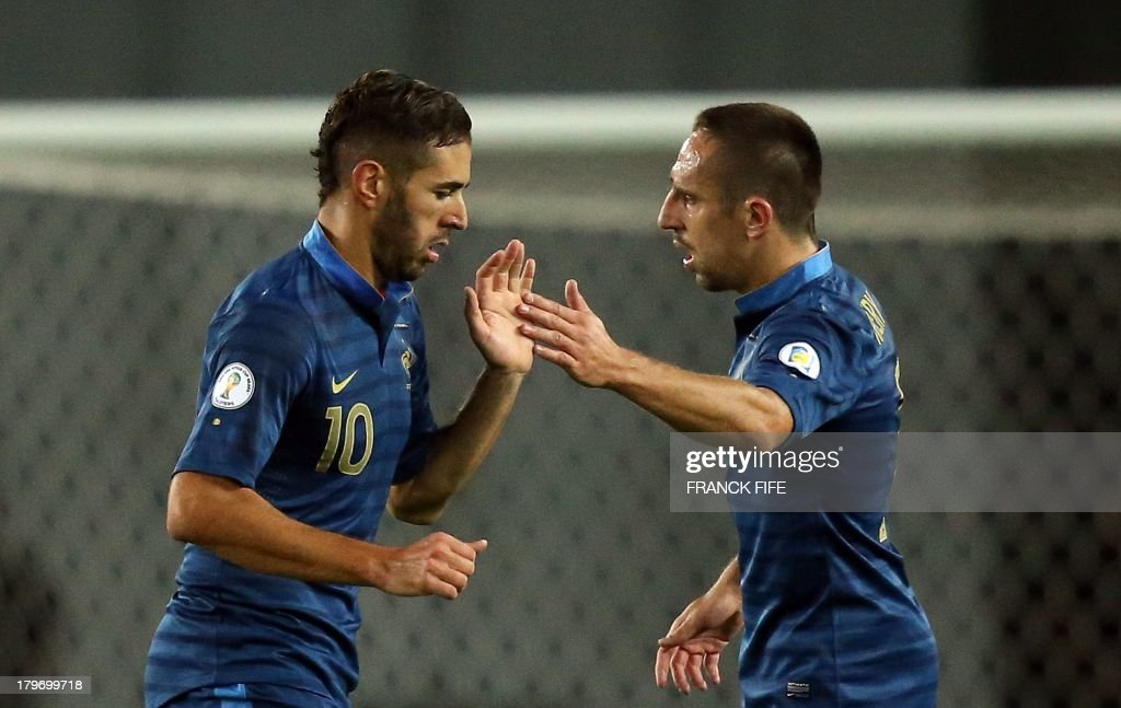 France's forward Karim Benzema (L) leaves a pitch next to France's forward Franck Ribéry during the FIFA World Cup 2014 qualifying football match Georgia vs France on September 6 2013 at the Boris Paichadze stadium in Tbilisi.