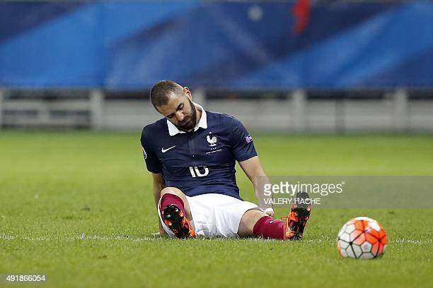 France's forward Karim Benzema reacts after being injured during the friendly football match between France and Armenia on October 8 2015 at the...