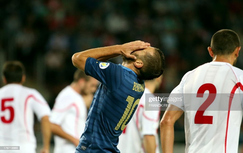 France's forward Karim Benzema reacts after missing a shot during the FIFA World Cup 2014 qualifying football match Georgia vs France on September 6 2013 at the Boris Paichadze stadium in Tbilisi. AFP PHOTO / FRANCK FIFE