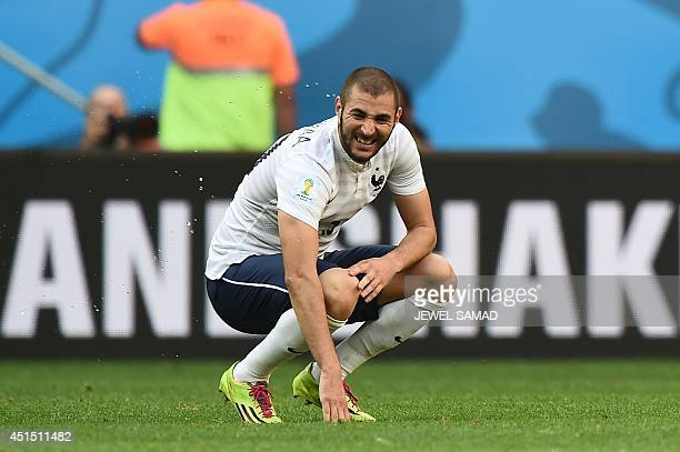 France's forward Karim Benzema reacts at the end of the round of 16 football match between France and Nigeria at the Mane Garrincha National Stadium...