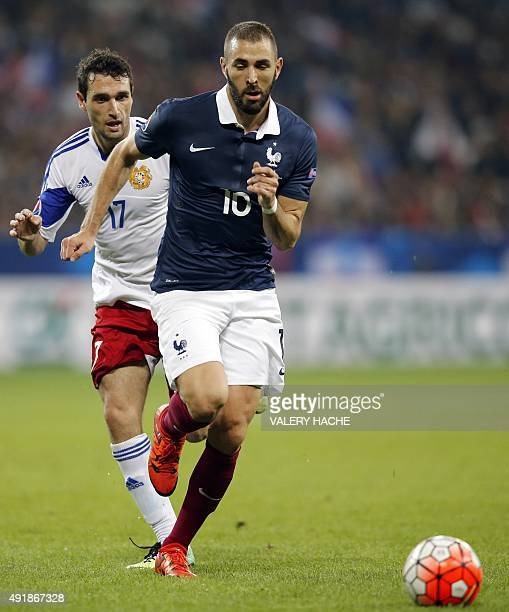 France's forward Karim Benzema vies for the ball with Armenia's midfielder Artur Yuspashyan during the friendly football match between France and...