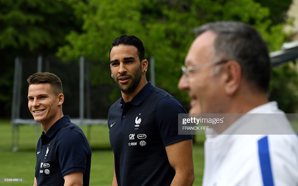 France's forward Kevin Gameiro (L) and defender Adil Rami walk at the French national football team training base in Clairefontaine on May 24, 2016, as part of the team's preparation for the upcoming Euro 2016 European football championships. / AFP / FRANCK