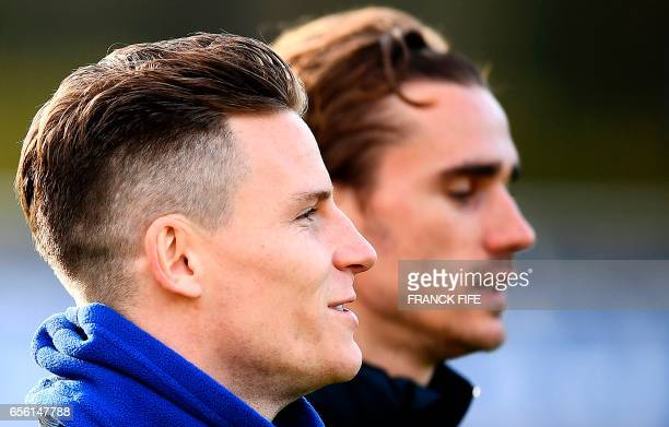 France's forward Kevin Gameiro and forward Antoine Griezmann run during a training session in Clairefontaine near Paris on March 21 as part of the...