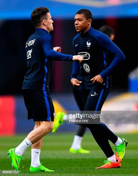 France's forward Kevin Gameiro and France's forward Kylian Mbappe take part in a training session at the Stade de France stadium in SaintDenis north...
