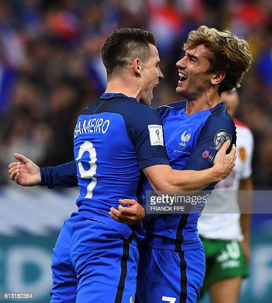France's forward Kevin Gameiro celebrates with teammate France's forward Antoine Griezmann after Gameiro scored his team's fourth goal during the...