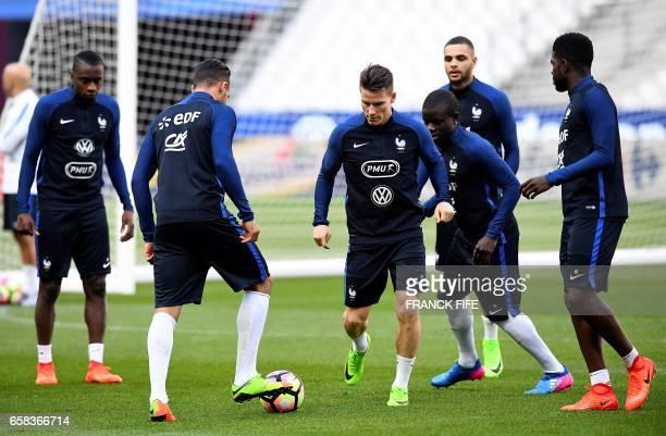 France's forward Kevin Gameiro controls the ball during a training session at the Stade de France in SaintDenis north of Paris on March 27 on the eve...