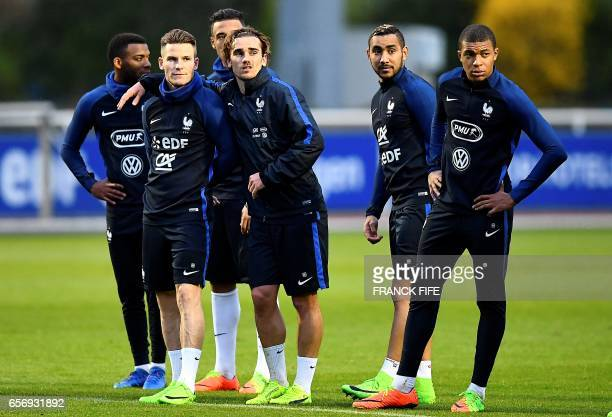 France's forward Kevin Gameiro forward Antoine Griezmann forward Dimitri Payet and forward Kylian Mbappe Lottin take part in a training session in...