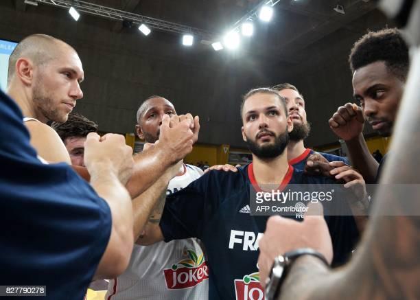 France's forward Kim Tillie shooting guard Nando de Colo forward Boris Diaw forward Joffrey Lauvergne and shooting guard Yakuba Quattara celebrate...