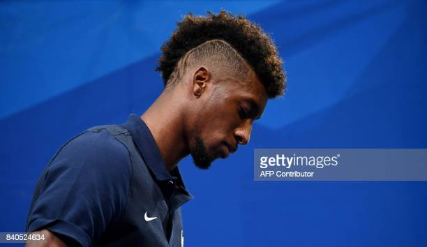 France's forward Kingsley Coman leaves a press conference in Clairefontaine en Yvelines on August 29 as part of the team's preparation for the FIFA...
