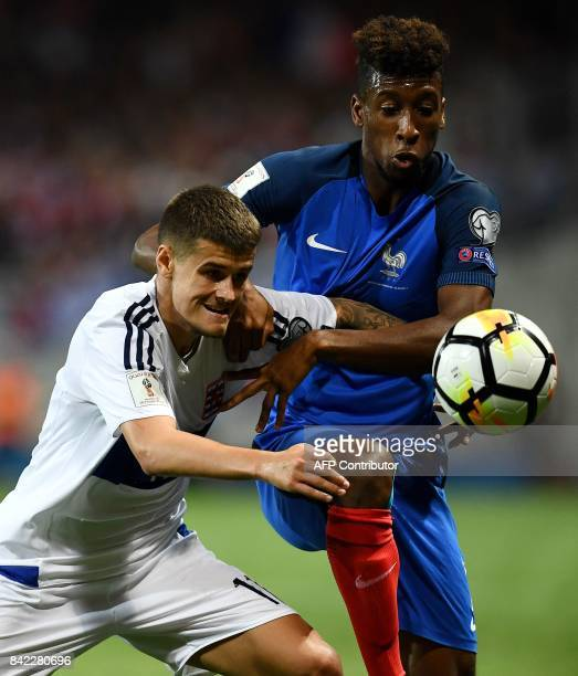 France's forward Kingsley Coman vies with Luxembourg's midfielder Olivier Thill during the FIFA World Cup 2018 qualifying football match France vs...