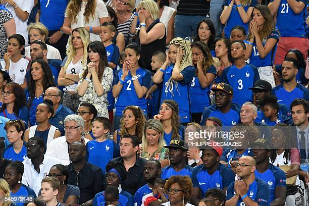 France's forward Kingsley Coman's wife Sephora Coman reacts during the Euro 2016 final football match between Portugal and France at the Stade de...