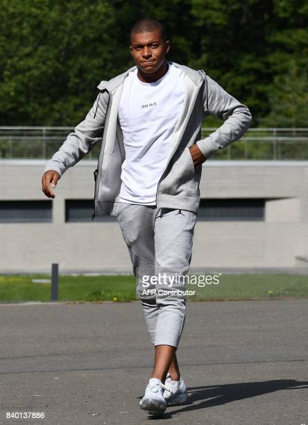 France's forward Kylian Mbappe arrives at the French national football team training base in Clairefontaine on August 28 as part of the team's...