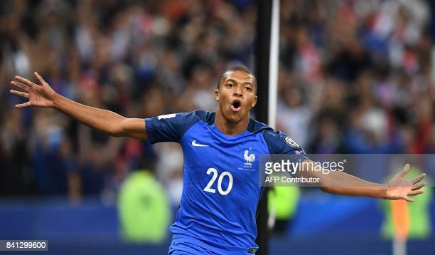 TOPSHOT France's forward Kylian Mbappe celebrates after scoring a goal during the 2018 FIFA World Cup qualifying football match France vs Netherlands...