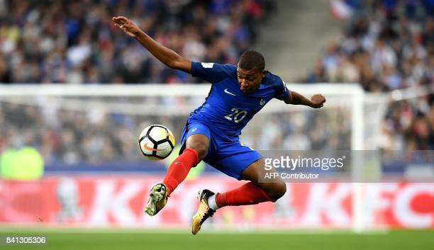 France's forward Kylian Mbappe controls the ball during the 2018 FIFA World Cup qualifying football match France vs Netherlands at the Stade de...