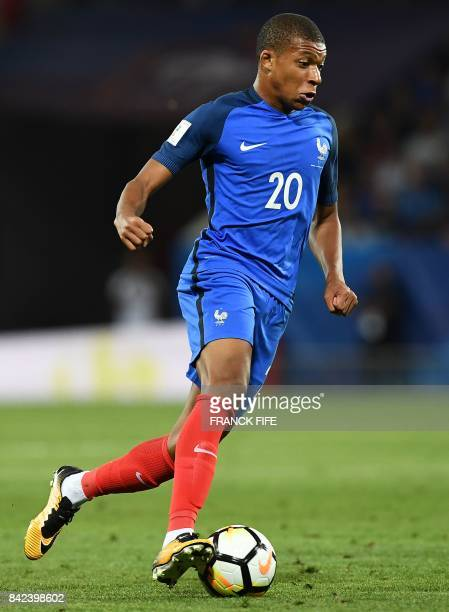 France's forward Kylian Mbappe controls the ball during the FIFA World Cup 2018 qualifying football match between France and Luxembourg on September...