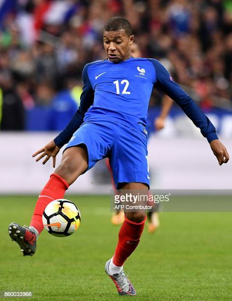 France's forward Kylian Mbappe controls the ball during the FIFA World Cup 2018 qualification football match between France and Belarus at the Stade...