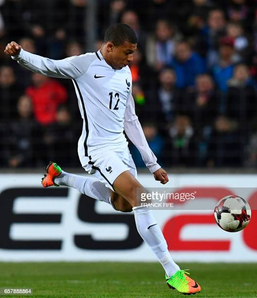 France's forward Kylian Mbappe eyes the ball during the FIFA World Cup 2018 qualifying football match Luxembourg vs France on March 25 2017 at the...