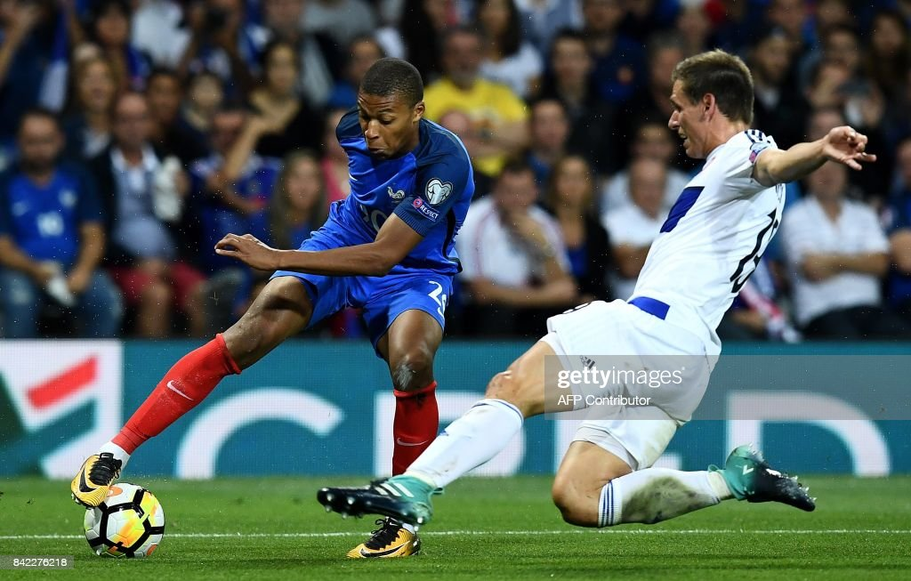 France's forward Kylian Mbappe (L) fights for the ball with Luxembourg's defender Dirk Carlson during the FIFA World Cup 2018 qualifying football match France vs Luxembourg at The Municipal Stadium in Toulouse, southern France on September 3, 2017. /
