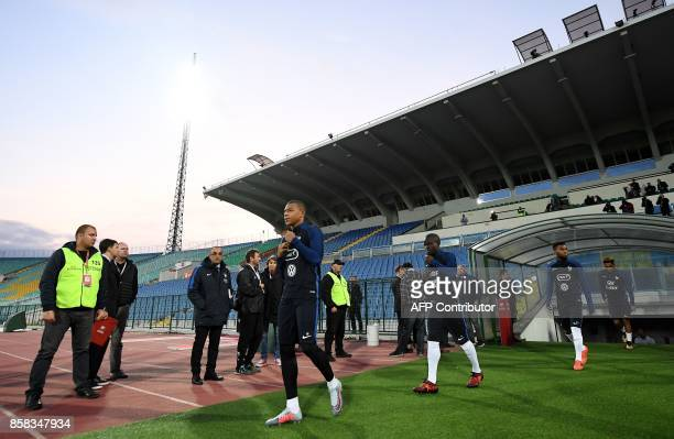 France's forward Kylian Mbappe France's midfielder N'Golo Kante and France's forward Thomas Lemar arrive for a training session at the Vasil Levski...