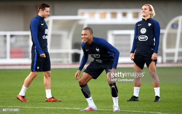 TOPSHOT France's forward Kylian Mbappe jokes during a training session in ClairefontaineenYvelines on October 3 in preparation for the team's World...