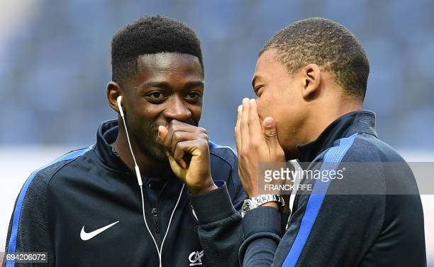 France's forward Kylian Mbappe jokes with France's forward Ousmane Dembele ahead of the FIFA World Cup 2018 qualifying football match Sweden vs...