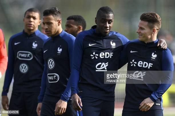 France's forward Kylian Mbappe midfielder Corentin Tolisso midfielder Blaise Matuidi and forward Kevin Gameiro arrive fora training session in...