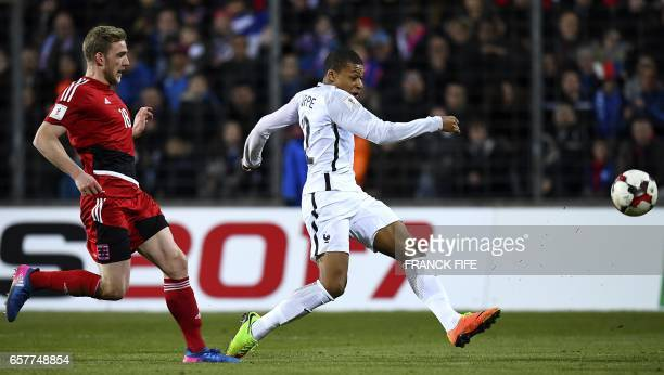 France's forward Kylian Mbappe outruns Luxembourg's Yann Matias Marques during the FIFA World Cup 2018 qualifying football match Luxembourg vs France...
