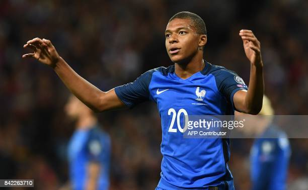 France's forward Kylian Mbappe reacts after missing a shot on goal during the FIFA World Cup 2018 qualifying football match France vs Luxembourg on...