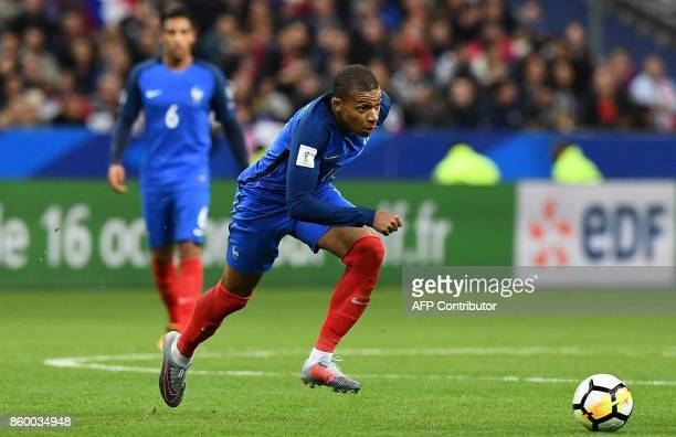 France's forward Kylian Mbappe runs after the ball during the FIFA World Cup 2018 qualification football match between France and Belarus at the...