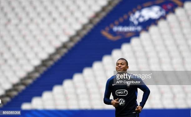 TOPSHOT France's forward Kylian Mbappe runs during a training session at the Stade de France stadium in SaintDenis north of Paris on the eve of the...