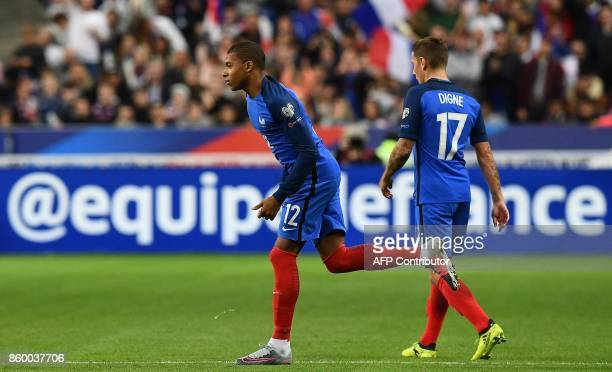France's forward Kylian Mbappe runs during the FIFA World Cup 2018 qualification football match between France and Belarus at the Stade de France in...