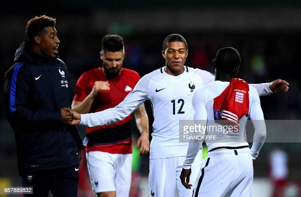 France's forward Kylian Mbappe shares a joke with France's defender Presnel Kimpembe at the end of the FIFA World Cup 2018 qualifying football match...