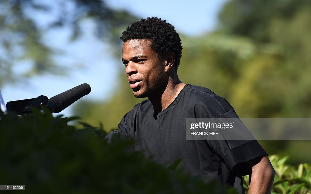 France's forward Loic Remy arrives at the French national football team training base in Clairefontaine on September 1, 2014 on the first day of their training ahead of the friendly football match against Spain to be held on September 4.