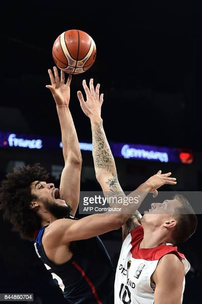 TOPSHOT France's forward Louis Labeyrie tries to score a basket against Germany's forward Daniel Theis during FIBA Eurobasket 2017 men's round 16...