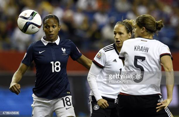 France's forward Marie Laure Delie vies with Germany's defender Annike Krahn during the quarterfinal football match between Germany and France in the...