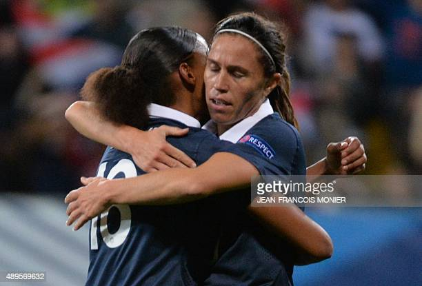 France's forward MarieLaure Delie is congratulated by France's midfielder Camille Abily after scoring a goal during the Women's Euro 2017 qualifying...